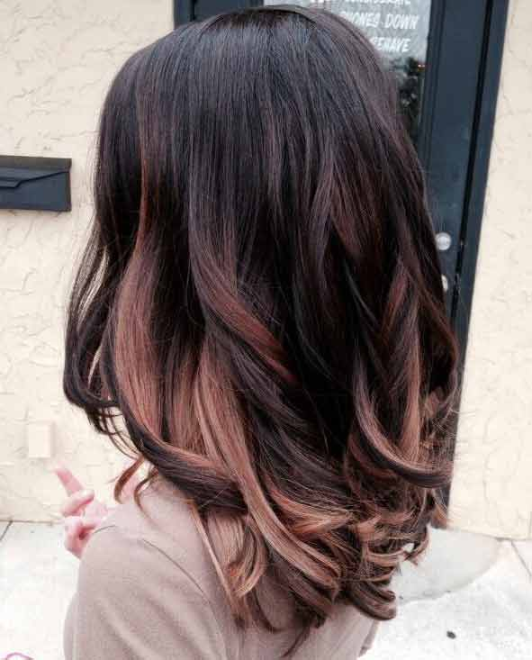 Rose gold highlights on black hair